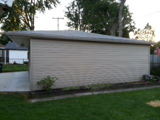 442478-579596-tb-siding_and_2_car_garage_with_gutters-_siding_page